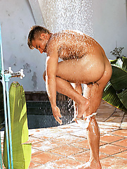Sexy guy in jockstrap under outdoor shower