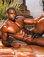 Massive black dude relaxing at the pool bench - Gay porn pics at Gaystick