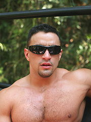 Strong macho posing outdoor - Gay porn pics at GayStick.com