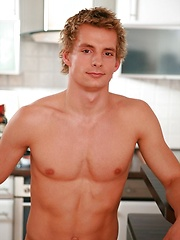 Curly stud Mark Huckleberry posing in the kitchen - Gay porn pics at GayStick.com