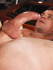 Two hot gay buddies have anal in the garage - Gay porn pics at GayStick.com