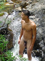 Handsome latin twink strips and poses outdoors - Gay porn pics at GayStick.com