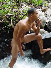 Handsome latin twink strips and poses outdoors