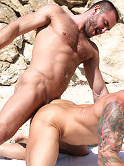 Jessy Ares tops Mitchell Rocks ass on the wild beach