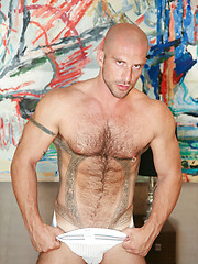 Muscled bald gay with hairy chest riding hard love tool - Gay porn pics at GayStick.com