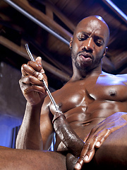 Ebony gay Race Cooper playing with his oiled dick and metal rod - Gay porn pics at GayStick.com