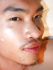 Asian guy Vodga is receiving a hot golden shower from his friend before facial - Gay porn pics at GayStick.com