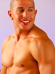 As he strokes he talks dirty to the camera and flashes his beaming smile - Gay porn pics at GayStick.com