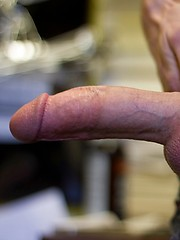Red-headed hottie Christian Collins really enjoys his big dick, and loves lapping up drops of pre-cum - Gay porn pics at GayStick.com