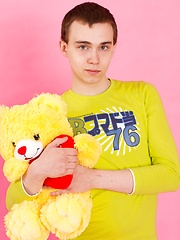 Straight guy Timmy Wright exposes his body with teddy in hands