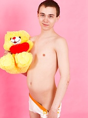 Straight guy Timmy Wright exposes his body with teddy in hands - Gay porn pics at GayStick.com