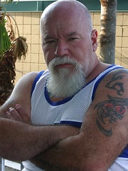 Sexy daddy Noah Post is not shy about showing off his tat, muscles or his furry body