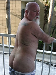 Sexy daddy Noah Post is not shy about showing off his tat, muscles or his furry body - Gay porn pics at GayStick.com