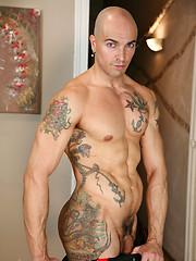 Two hot tattoed studs Duda and Rodrigo Calas - Gay porn pics at GayStick.com
