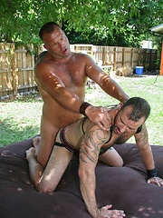 Sexy linebacker built Brock Hart is paired with sexy Muscle Bear Steve King in the hot Florida sun - Gay porn pics at GayStick.com
