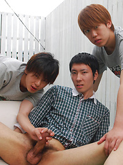 Kaede and Fuji grab the lube and a dildo and bend Jo over the small couch pulling off his shorts - Gay porn pics at GayStick.com