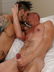 Draven is on his knees leaning backwards as Jayson is on all fours with his face buried in his pubes - Gay porn pics at GayStick.com