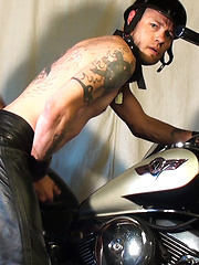 Ray Dalton breeding Damon Dogg on his motorcycle