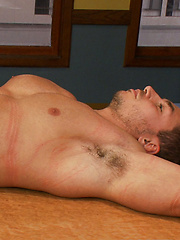 Marc Dylan is spread out on a table in bondage - Gay porn pics at GayStick.com