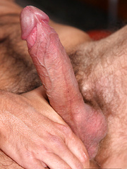 A hairy, Greek guy, bearded, burly and sporting a corking two-hander of thick, juicy meat - Gay porn pics at GayStick.com