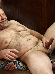 Beefy daddy bear Jack Snow is great to curl up with in the sun on the back porch - Gay porn pics at GayStick.com