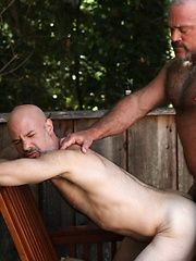 Evan Scott is intrigued and thrilled when muscle-bear Bronson Gates trespasses on his property for a cold drink of water - Gay porn pics at GayStick.com
