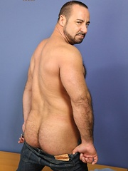 Sexy Rocky LaBarre has massive biceps, a furry chest and a huge rock-hard cock - Gay porn pics at GayStick.com