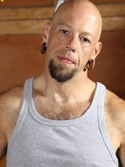 Tough tattooed bear Budd Cort is one hard worker - Gay porn pics at GayStick.com