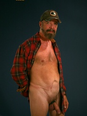 Daddy bear Rocky Nelson travels the long hard road looking for other bears some needed roughhousing - Gay porn pics at GayStick.com