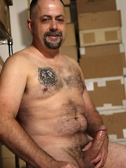 Sexy bear Gus is ready for some heavy petting and hot playtime especially when he's bored at work - Gay porn pics at GayStick.com