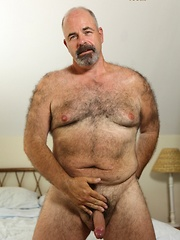 Furry bear Tony Thompson is sweating out the summer heat with strokin' his big uncut man meat - Gay porn pics at GayStick.com