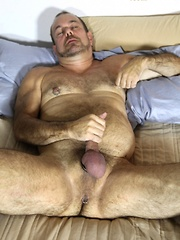 Stephen Edwards is one sexy barrel-chested bear with his pretty green eyes, beard, muscular body and hairy chest - Gay porn pics at GayStick.com
