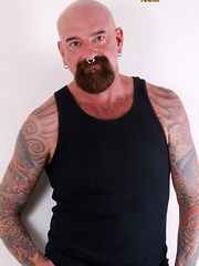 Southern bear Tex Madux is a tough tatted man that likes to fuck with his work boots on