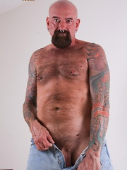 Southern bear Tex Madux is a tough tatted man that likes to fuck with his work boots on - Gay porn pics at GayStick.com