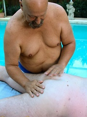 After a hard fuck these bears can relax by the pool - Gay porn pics at GayStick.com