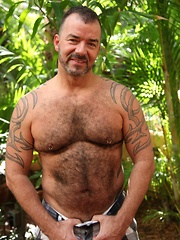 Furry bear Steve King loves to stroke his hard cock in the Florida sun