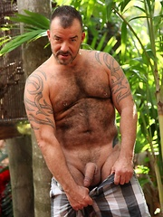Furry bear Steve King loves to stroke his hard cock in the Florida sun - Gay porn pics at GayStick.com