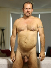 Sexy daddy bear Stephen Edwards loves a massage with a happy ending - Gay porn pics at GayStick.com