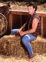 Sexy cowboy posing outdoor