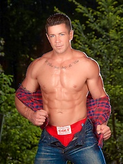 Trenton Ducati in red panties - Gay porn pics at GayStick.com