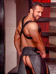 Adam Champ posing in leather skirt - Gay porn pics at GayStick.com