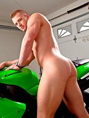 Hot stud James Huntsman with a green bike - Gay porn pics at GayStick.com