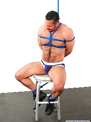 Muscular hunk tied up & cums - Gay porn pics at GayStick.com