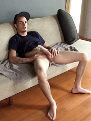 Jacob Pike sitting in the coach and stroking cock - Gay porn pics at GayStick.com