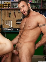 The boss of the motorcycle repair shop likes a hot butt for his hot rod - Gay porn pics at GayStick.com