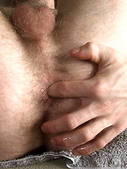 Brutal stud plays with his cock - Gay porn pics at GayStick.com