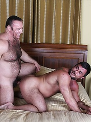 Brad Kalvo fucks Mike Dozer doggystyle on the bed with his cock suffocating on a rubber - Gay porn pics at GayStick.com