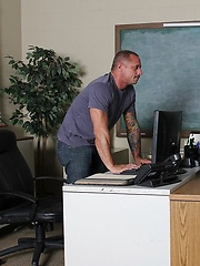 The hunky Kyle Savage is busy at his desk but is soon distracted by Tyson James' rock hard cock