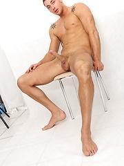 Athletic stud Enzo Bloom masturbates his hard cock. - Gay porn pics at GayStick.com