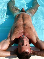 A turquoise pool and two lovers sharing their affection - Gay porn pics at GayStick.com